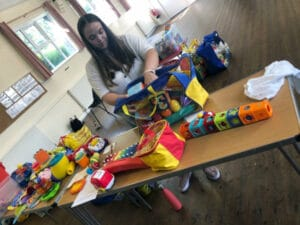 Beth building our purposeful play packs